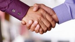 2000 --- Shaking Hands --- image100/Corbis (Newscom TagID: corimages024450)     [Photo via Newscom]